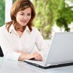 Businesswoman with laptop image